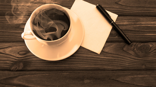 Cup of coffee, napkin, pen on wooden table background. coffee-break.